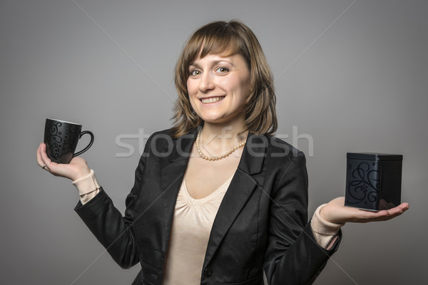Young woman with cup and tea tin Stock photo © w20er