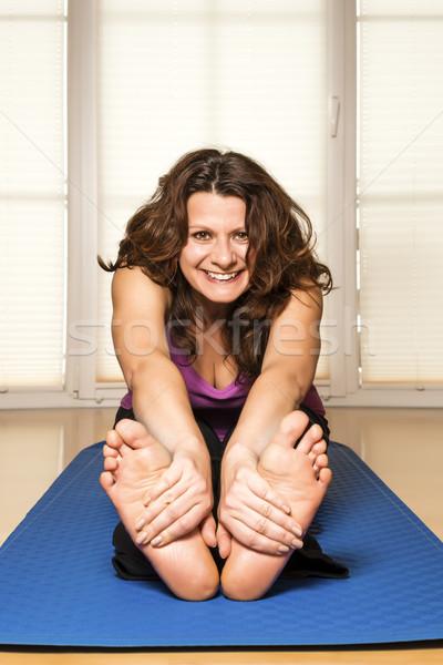 Fitness woman stretch back Stock photo © w20er