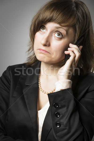 Business woman wonders on mobile Stock photo © w20er