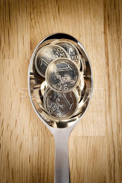 Euro coins on spoon Stock photo © w20er