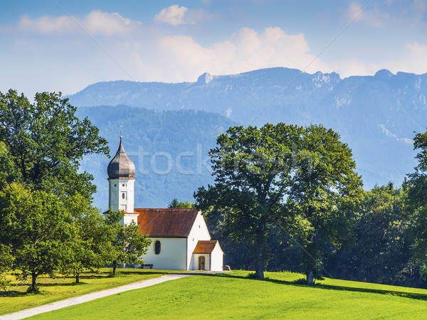 Küçük kilise çayır tipik ağaçlar dağlar gökyüzü Stok fotoğraf © w20er