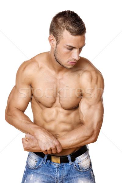 Sportowiec denim spodnie młody człowiek dobrze Zdjęcia stock © w20er