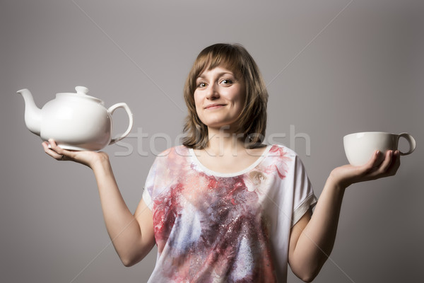 Woman with white tea cup and tin Stock photo © w20er