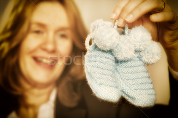 Blond woman with baby shoes Stock photo © w20er