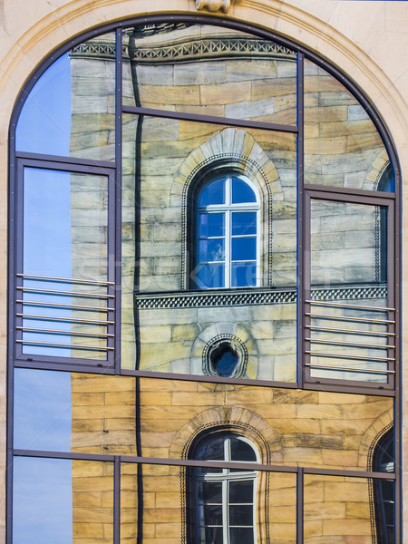 Mirroring of a old house in window Stock photo © w20er