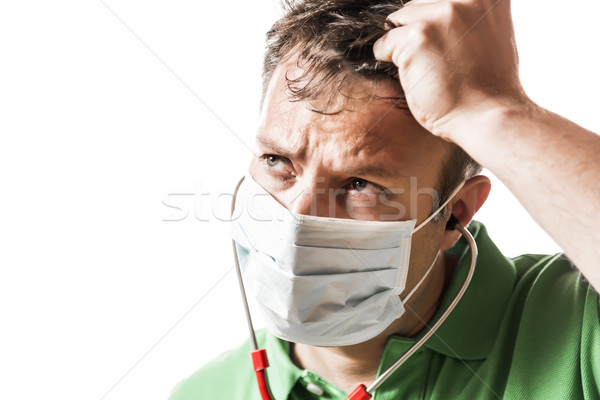 Helpless, anxious and perspiring doctor Stock photo © w20er