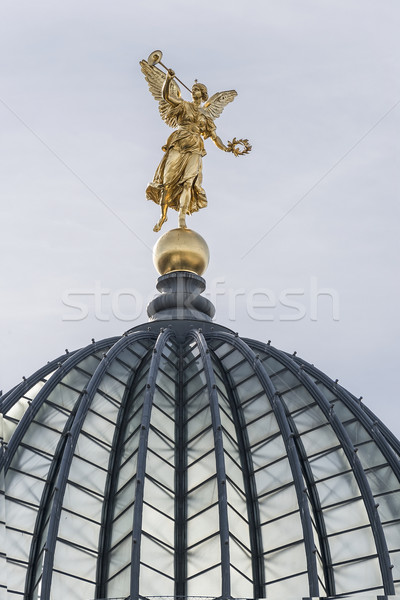 Stock photo: Golden Statue with trumpet