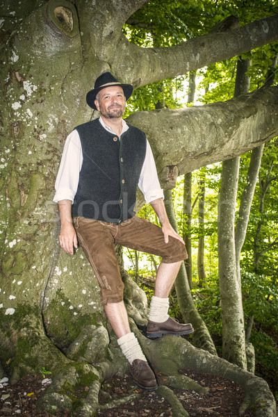 Man with traditional costume in forest Stock photo © w20er