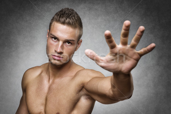 Athlete holds up his hand Stock photo © w20er