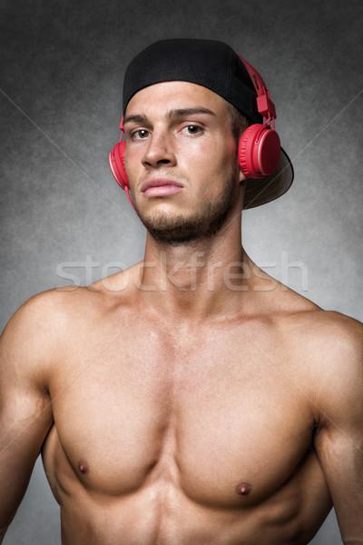 Atleet cap hoofdtelefoon portret jonge man goed Stockfoto © w20er