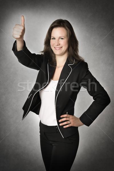 Zakenvrouw duim omhoog vrouw permanente kantoor Stockfoto © w20er