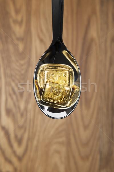 Altın kaşık görüntü iki para arka plan Stok fotoğraf © w20er
