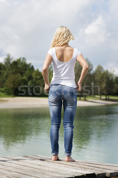 Blond woman standing on jetty Stock photo © w20er