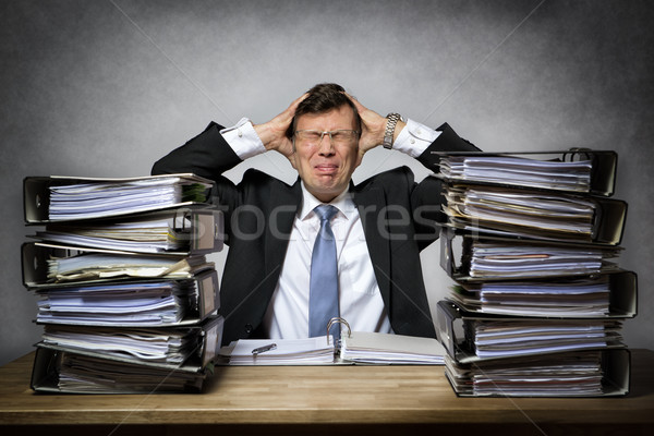 Overworked stressed businessman Stock photo © w20er