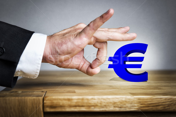 Man shoots Euro sign off Stock photo © w20er