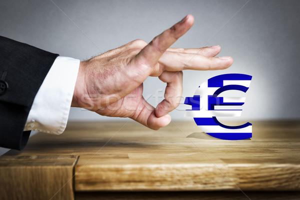 Man shoots greek Euro sign off Stock photo © w20er