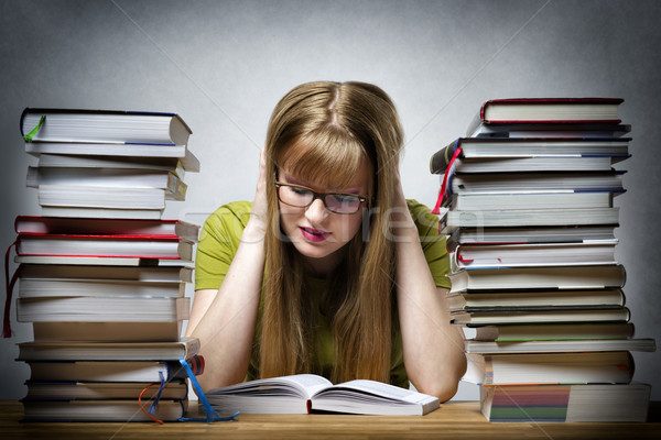 young woman is reading book Stock photo © w20er
