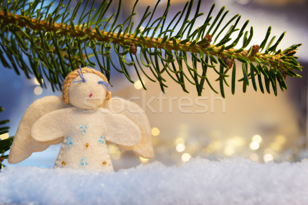 branch, felt angel on snow and bokeh lights Stock photo © w20er
