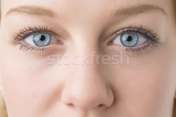Közelkép nő szemek fiatal szőke kék szemek Stock fotó © w20er