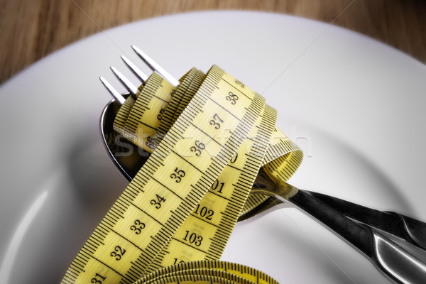 Tape measer with fork and spoon Stock photo © w20er