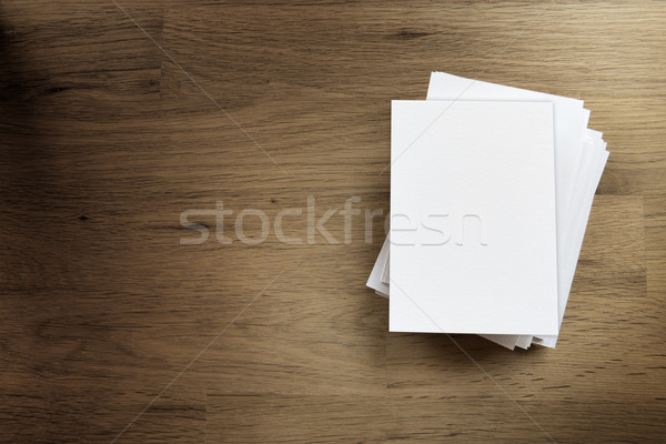 Blank paper card on wooden table Stock photo © w20er