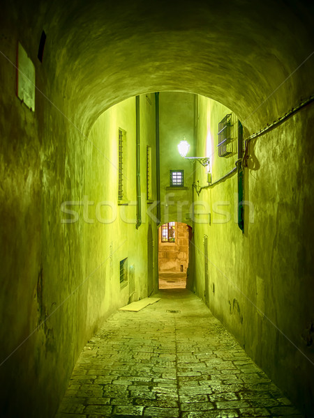 Narrow illuminated alley Stock photo © w20er