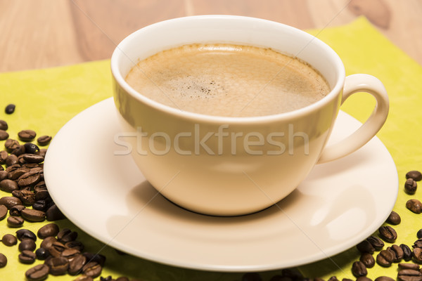 Cup of coffee with beans Stock photo © w20er