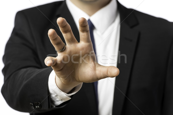 Businessman in a suit holds out his hand Stock photo © w20er