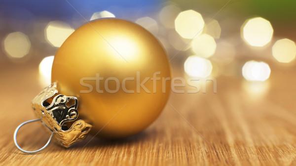 Altın önemsiz şey bokeh ışıklar görüntü ahşap masa Stok fotoğraf © w20er