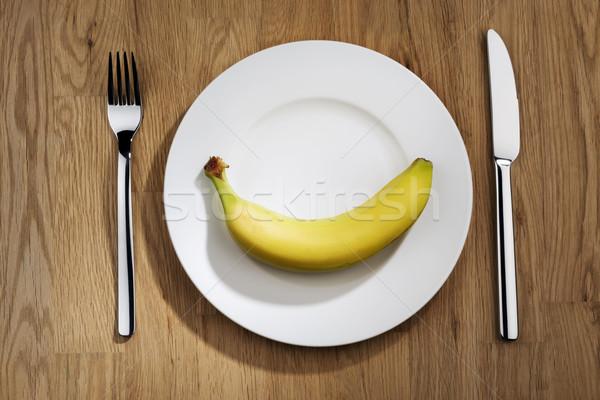 Banana prato branco garfo faca sorrir Foto stock © w20er