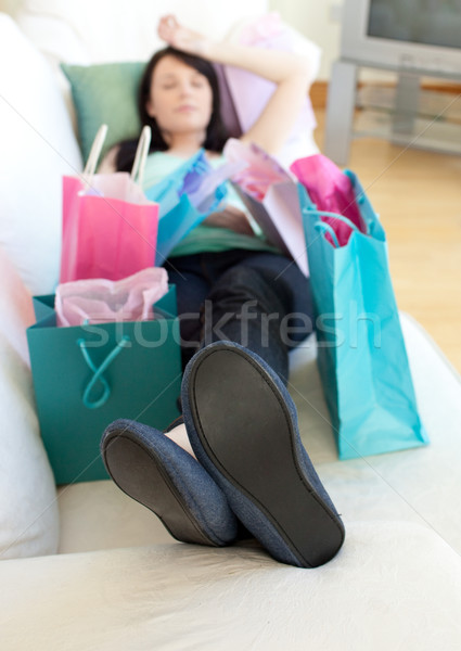 Exhausted woman relaxing after shopping Stock photo © wavebreak_media