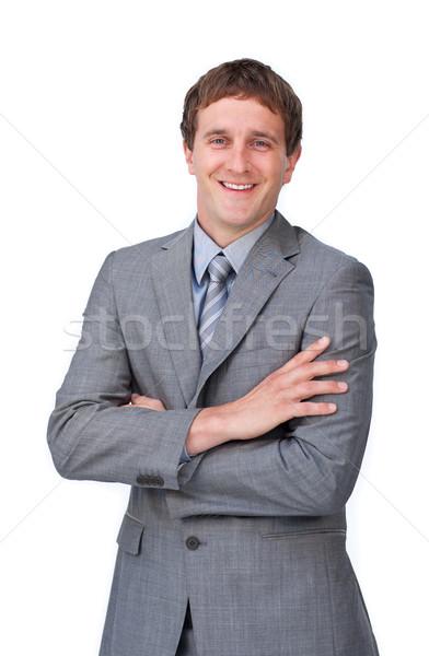 Positive businessman with folded arms Stock photo © wavebreak_media