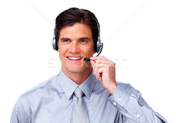 Positivo empresario hablar auricular blanco negocios Foto stock © wavebreak_media