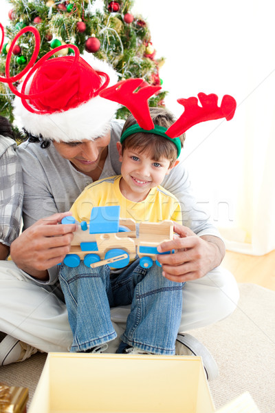 Happy child playing with a train with his father Stock photo © wavebreak_media