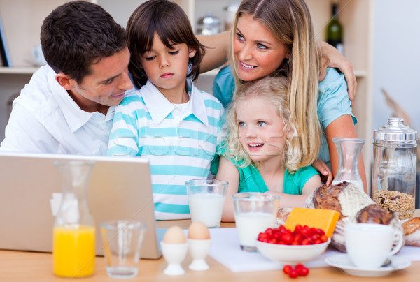 Blissful family using laptop during the breakfast Stock photo © wavebreak_media