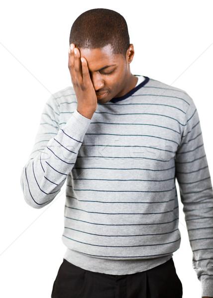 Upset man against a white background Stock photo © wavebreak_media