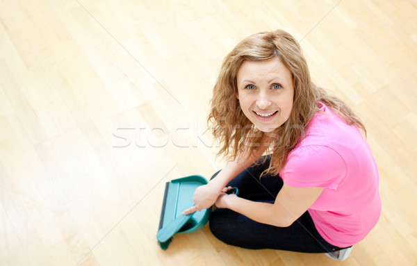 Stock photo: Happy young woman doing housework