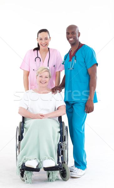 Nővér orvos néz beteg kerék szék Stock fotó © wavebreak_media