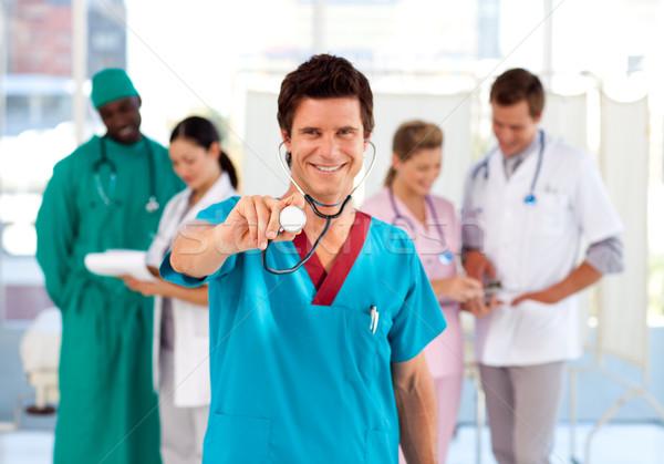 Médico equipe trabalhando hospital sorrir Foto stock © wavebreak_media