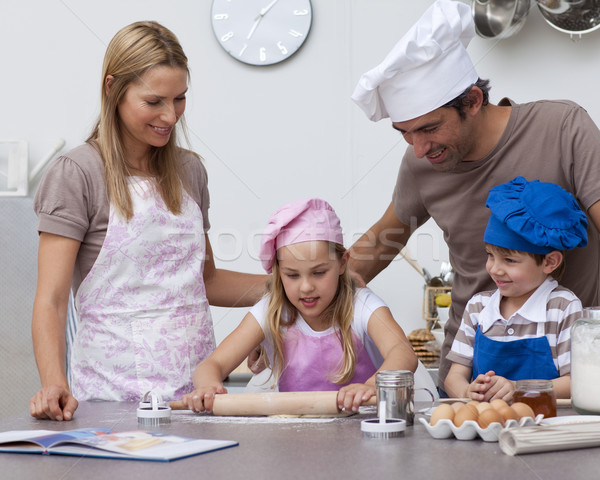 Parents helping children baking in the kitchen Stock photo © wavebreak_media