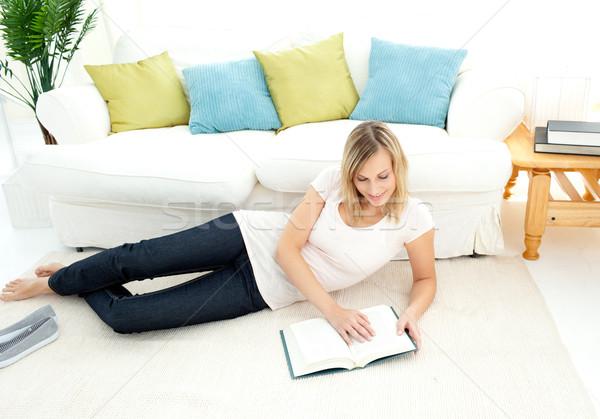 Charming woman is reading a book  Stock photo © wavebreak_media