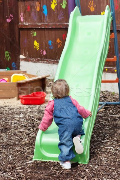ストックフォト: 女の子 · 遊び場 · 家族 · 少女 · 笑顔