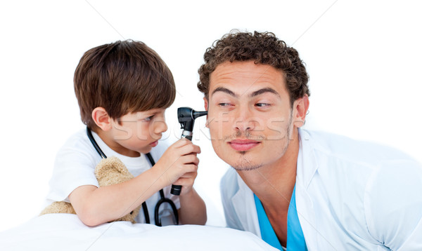 Concentrated little boy playing with the doctor at the hospital Stock photo © wavebreak_media