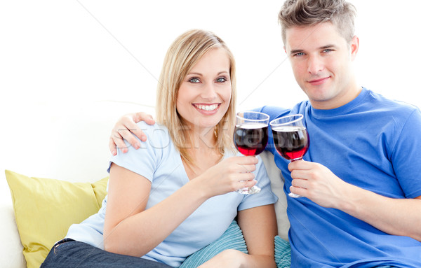 Cute couple drinking wine together in the living-room at home Stock photo © wavebreak_media