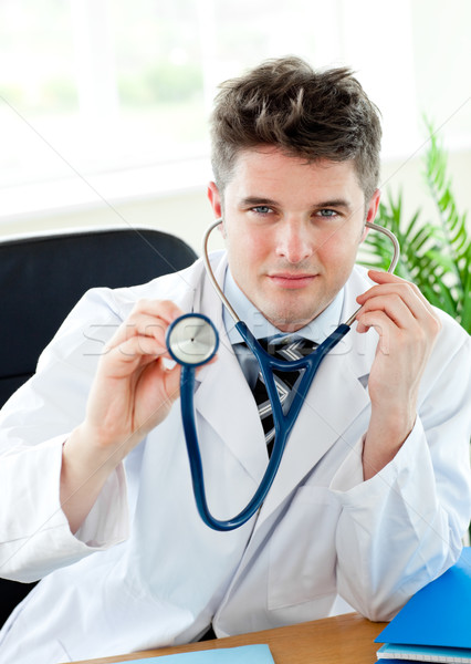 Sorridente médico estetoscópio isolado médico hospital Foto stock © wavebreak_media