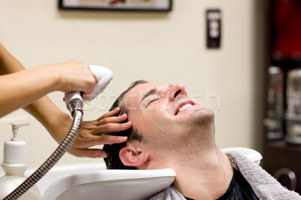 Handsome man having his hair washed Stock photo © wavebreak_media