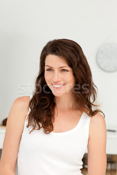 Stock photo: Portrait of a beautiful woman standing in her kitchen at home