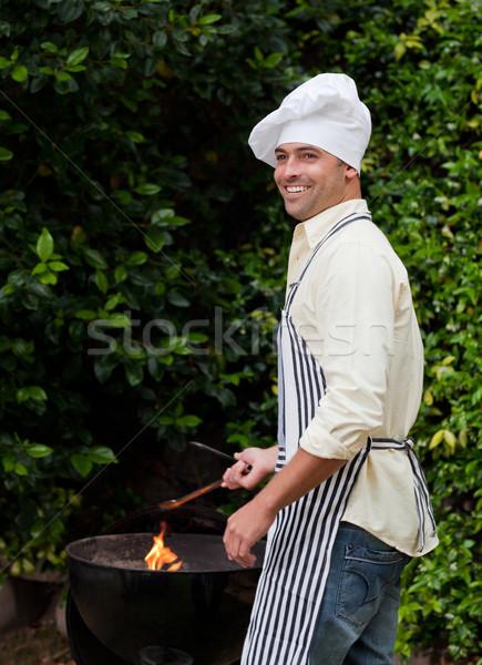 Férfi barbecue kert ház étel mosolyog Stock fotó © wavebreak_media