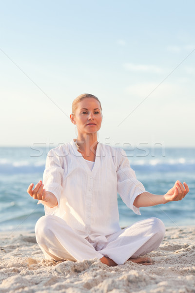 Stock photo: Peaceful woman practicing yoga