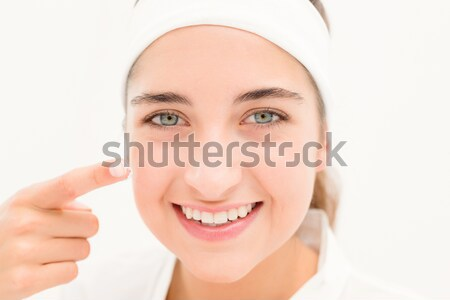 Stock photo: Portrait of a beautiful woman posing while standing against a white background